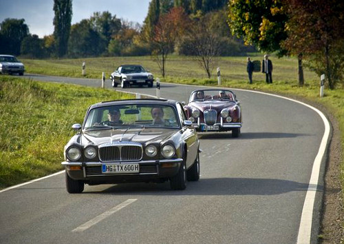 Oldtimers cruising along the country roads